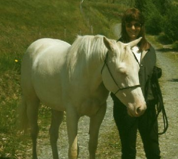 Cremello Quarter Horse Kitty and the author Dr. Glynis Giddings